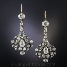 Exquisite diamond dangles dating back to the late-Victorian period, circa 1890. Superbly hand-fabricated in silver over gold, fanciful bell shaped bottoms are each centered with a sparkling white pear shape diamond that swing and sway below round diamond tops (added at a later date). 1 3/4 inches long and exceptionally lovely.