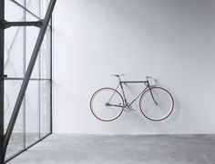 These minimal wooden bike hooks present an elegant and clever way to store your bespoke bicycle at home. Conceived as a piece of high-quality furniture rather than a mere practical device they offer an extremely simple but sophisticated storage solution for light sports bikes. Meticulously hand-turned from sustainable hardwood either in oak wood or american black walnut they pay tribute to your bike as a design object and also look beautiful on their own.  This pair comes in plain oak wood…