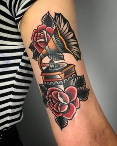 Traditional style gramophone tattoo on the left bicep. Tattoo Artist: Harry Harvey