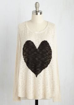 If you want a sweater with love in the stitches, then let this beige pullover give you a haute hug! This open-knit piece promotes passion with its black heart intarsia and dedication to chic comfort.