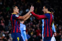 Alexis Sanchez (L) of FC Barcelona celebrates with his team mate Pedro Rodriguez after scoring his team's third goal during the La Liga match between FC Barcelona and Malaga CF at Camp Nou on January 26, 2014 in Barcelona, Catalonia.