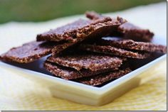 raw cocoa crackers  1 cup cashews 1/3 cup flax meal 1/4 tsp salt 1/4 cup cacao nibs 1/2 cup date paste Scant 1/2 cup water (or as needed) 2 tbsp chia seeds