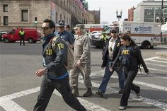 First responders and investigators are near the scene of multiple explosions at the end of the Boston Marathon finish line in Boston, Massachusetts April 15, 2013. REUTERS-Scott Eisen