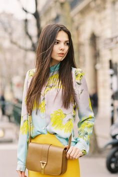 floral print blouse + popular bag shape of the moment + bright yellow skirt. classy and trendy.
