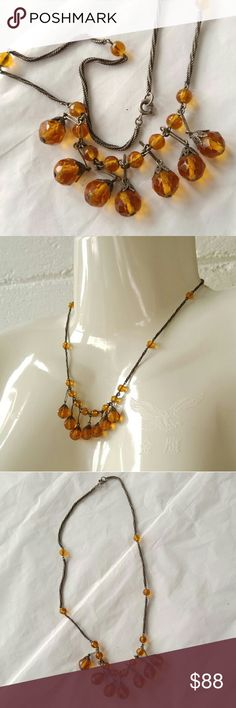 Vtg amber glass drop necklace silver tone Gorgeous vintage necklace with faceted amber color glass beads on a nice silver tone chain ( may be sterling but is not signed so not positive) This necklace seems to be pretty old, pre 1960s - it is weighty and high quality - in nice condition with slight darkened patina to the metal - from a smoke free home -offers are welcome :) Vintage Jewelry Necklaces