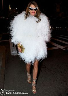 Anna Dello Russo isn't known for being demure in her fashion choices. Bold as always, she attended the Marc Jacobs F/W 2012 show in YSL's feather coat and embellished cat eye glasses.
