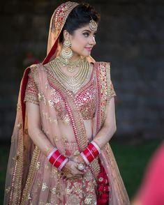Looking for Red bridal lehenga with gold sequin work? Browse of latest bridal photos, lehenga & jewelry designs, decor ideas, etc. Designer Bridal Lehenga, Indian Bridal Lehenga, Indian Bridal Outfits, Indian Bridal Makeup, Indian Bridal Fashion, Indian Bridal Wear, Indian Dresses, Bridal Dresses, Wedding Lehnga