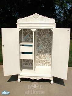 Love this idea of refinishing a cabinet with wallpaper inside