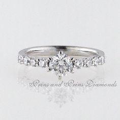 Centre diamond is 0.62ct H/VS2 Round brilliant cut diamond with 8 = 0.40ct GH/VS – SI round diamonds claw set in 18k white gold