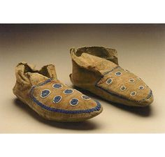 Crow Tobacco Society moccasins (side seam style; pony beads and seed beads) Edwards Family Collection. (The Antique Tribal Art Dealers Association, Inc.)