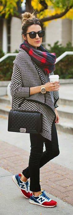 Casual fall street style. Totally rocking those sneakers with an oversized, asymmetric sweater.