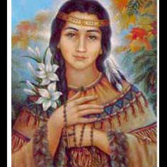 St. Kateri (Mohawk for Catherine), first Native American saint. She was threatened with death if she did not renounce Catholicism. In 1677, she began a 200-mile walking journey to a Christian Indian village near Montreal. Kateri led a life of prayer and penitence, taught the young, & helped those in the village who were poor or sick. When she died, witnesses said that her emaciated face became like a healthy child. The lines of suffering & pockmarks disappeared and a smile came upon her…