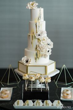 The octagonal bottom of this cake accentuated by the gold lining is the ultimate geometric statement   Photography by: Lisa Mark Photography   WedLuxe Magazine   #wedding #luxury #weddingcake