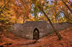 Poinsett Bridge SC. Located near Greenville, built in 1820, is believed to be oldest surviving bridge in S.C.  Named for Joel Poinsett who brought poinsettia flowers to the U. S. Constructed from quarried stone, it features parapet sidewalls and is marked by a 15-foot Gothic arch which forms a passsage for Little Gap Creek.  Part of the Poinsett Bridge Heritage Preserve,