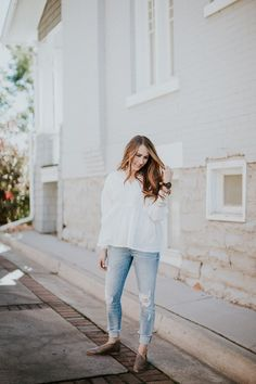 Love how simple yet functional this look is. The white texture top with distressed denim and booties.