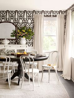 """The old curtains were the home-decor equivalent of a dowdy skirt that hits midcalf; new floor-length, linen drapes """"give off a relaxed elegance,"""" says Sara. #countrylivivng"""
