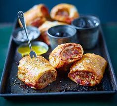 We're staking our bets on these being the best sausage rolls you… Love Marmite? We're staking our bets on these being the best sausage rolls you've ever tasted. Cut them into mini portions as a canapé or keep them longer for a filling lunch Bbc Good Food Recipes, Cooking Recipes, Yummy Food, Crockpot Recipes, Sausage Recipes, Tasty, Savoury Baking, Savoury Pies, Savoury Recipes