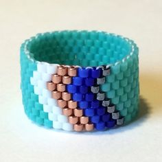 Turquoise Chevron Beaded Band Peyote Stitch Ring Tribal Boho Bohemian Native American Style Western Jewelry Affordable Gift by PuebloAndCo on Etsy https://www.etsy.com/listing/260796557/turquoise-chevron-beaded-band-peyote