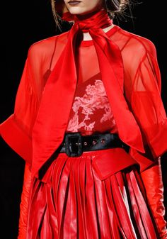 Layering 101. Sheer top over embellished slip and pleated leather skirt, topped off with scarf and gloves. Gorgeous! Givenchy fall 2012