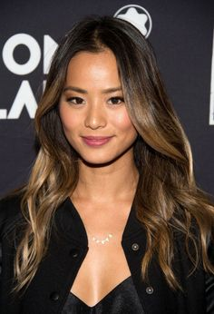 Jamie Chung with a perfect blowout and barely there makeup on June 20.
