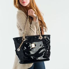 """Crafted of patent faux leather or sleek animal print and simply stunning, this tote has room enough for all your must-haves. Each color option features cleverly contrasting handles.  • Faux patent leather • 16"""" L, 11"""" H, 6.25"""" W • Handles with 10drop • Exterior pocket fits any Grace Adele Clutch"""