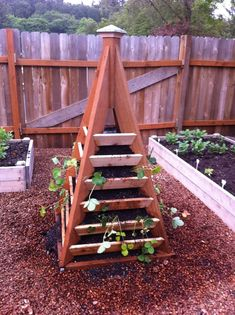 vertical pyramid raised garden bed great for herbs maybe - Google Search
