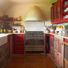Looking for country kitchen decorating ideas? Take a look at this red farmhouse-style kitchen from Homes & Gardens for inspiration. For more kitchen ideas, such as how to decorate with tiling, visit our kitchen galleries Family Kitchen, Kitchen Dining, Red Kitchen, Rustic Kitchen, Country Kitchen Designs, Country Kitchens, Red Farmhouse, Freestanding Kitchen, Kitchen Pictures