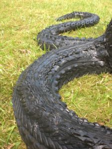 rubber art detail of a snake Outdoor Sculpture, Sculpture Art, Tire Art, Recycling, Trash Art, Tyres Recycle, Bicycle Tires, Scrap Metal Art, Garden Hose