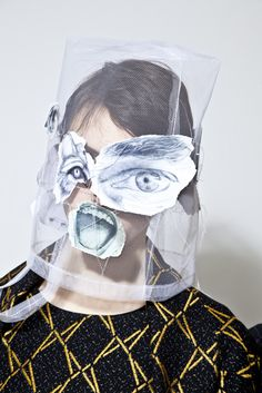 funny headdress (bags? faces with eyes? or anything else?) by dutch stylist Bernhard Willhelm. hats made with lino and styrofoam prints parts from Aw 2013-14 collection http://www.bernhard-willhelm.com