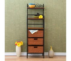 3 Drawer Rattan Baker Rack - Elegant and beautiful, this three-drawer kitchen rack will help with storage, display and organization all in one. Three lower brown stained rattan baskets function as removable drawers while three open shelves on top provide versatility. Decorative scrollwork laces the top for a classic touch. www.millstores.com