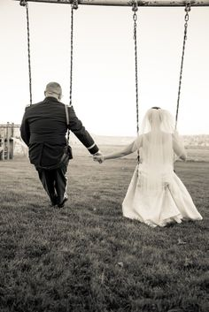 Groom & bride playfully swinging together.  Copyright Photographics Solution 2013