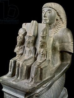 Statue of the First Priest of Amun, Ramessunakht, with the Theban Triad - detail (Amun seated in the middle, to his left his wife the goddess Mut and their son Khonsu sitting at his father's right). Karnak, Temple of Amun-Re, 20th Dynasty, Reign of Ramesses IV / Cairo, Egyptian Museum.
