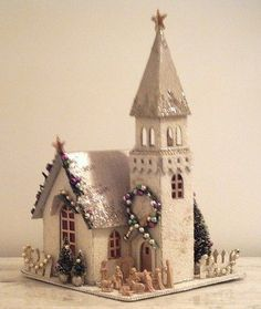 It's Beginning to Look a Lot Like Christmas with These Village Houses Christmas Village Houses, Christmas Town, Putz Houses, Christmas Villages, Noel Christmas, Christmas Paper, All Things Christmas, Vintage Christmas, Christmas Glitter