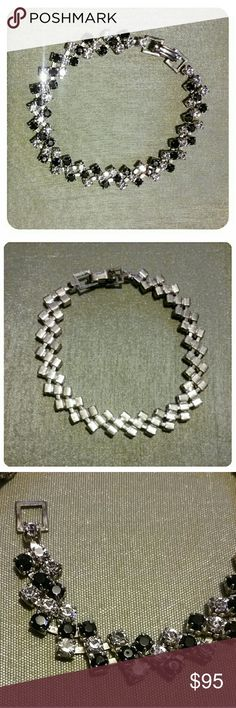 Vintage Black & Clear Rhinestone Bracelet Silver This unique piece is in exceptional vintage condition! All the stones are clear and bright. The silver tone is in incredible condition. The clasp works wonderfully. Each link boasts three diagonal stones.   Bundle and Save More!! Vintage Jewelry Bracelets