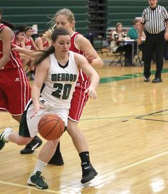 Jackie Friel of Mendon gets by Constantine defenders on Friday night.