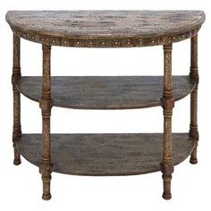Distressed three-tier console table.    Product: Console tableConstruction Material: WoodColor: BrownFeatures: Two shelvesDimensions: 32 H x 36 W x 16 D