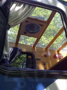 Open ceiling design with a tarp that rolls back and screen covering the frame. Nice!