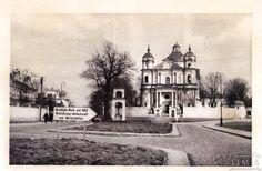 1944 metai. Šv. Petro ir Povilo bažnyčia ir rodyklė į HKP - karinės technikos remonto dirbtuves Olandų g., kuriose dirbo Vilniaus geto kaliniai (nuotr. Sofijos Urbonavičiūtės-Subačiuvienės. Valstybinis Vilniaus Gaono žydų muziejus).