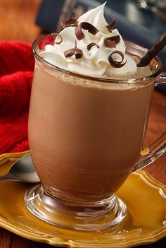 A dessert worthy hot cocoa recipe starts with cocoa mix and instant coffee made with milk and topped with Reddi-wip
