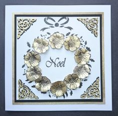 'A Touch of Gold' card.  Imagination Craft's - Magi-bond glue.  Black & White gold Starlight Paints.Christmas Rose stamp from the Christmas Rose decoupage stamp set.  'Noel' stamp from the Poinsettia decoupage stamp set.   Tattered Lace corner die.  Black ink pad.  June 2015