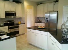 White Kitchen Cabinets with Granite Countertops I would totally paint the kitchen white if I could get D on board.