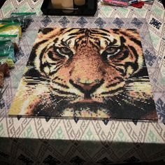 Project #4: Crouching Tiger . One of my favorite pieces so far. #perler #perlerbeads #tiger