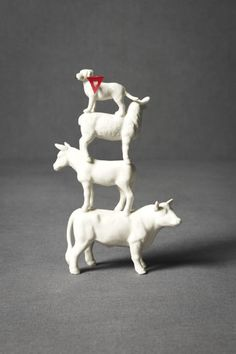 Cake Topper (but it's expensive)....I'm thinking I can buy plastic toy animals, paint them white, hot glue them together, and... voila!