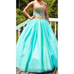 Beautiful Jovani prom dress! Aqua and gold See through corset prom dress. Completely covered in rhinestones! Worn once! Size 6! Jovani Dresses