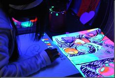 Black light painting!!!  Neon tempera paint and black lights ordered from Amazon.
