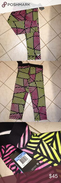 NWT Nike Crops brand new with tags nike patterned crop leggings in perfect condition. never worn Nike Pants Ankle & Cropped