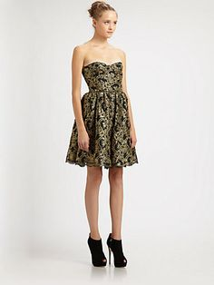 Obsessed with black & gold. Christmas dress?  Alice + Olivia - Caryn Bustier Dress - Saks.com