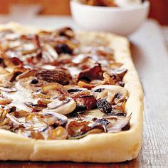 Fresh mushroom fans will devour this garlic- and rosemary-infused pizza. Fontina cheese melts beautifully into the crust, contributing a sweet and mild earthy taste.