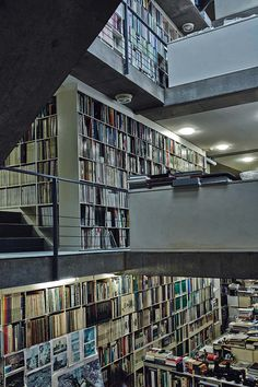 tadao-ando studio: walls throughout the building accommodate shelves filled with books and magazines-02