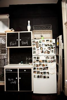A kitchen in chalkboard paint. I do like this for cupboards or closets with ever-evolving contents.